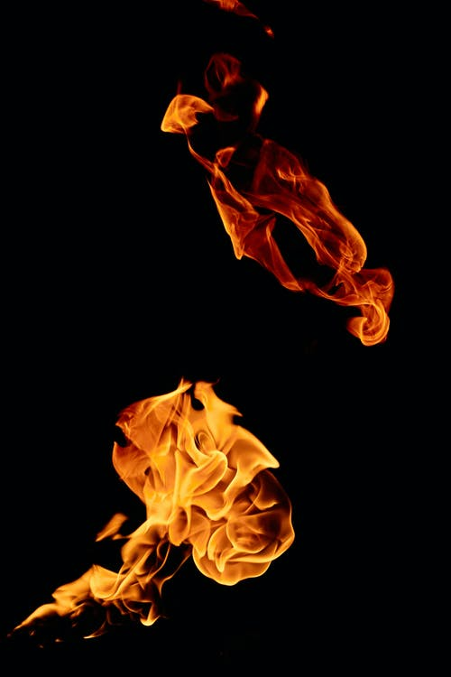 Two flames on black background