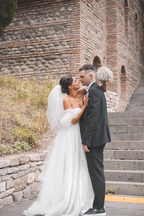 Gratis stockfoto met affectie, bruid, bruidegom