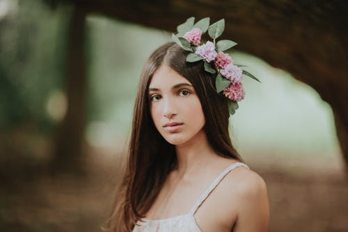 Portrait of girl with flowers in hair