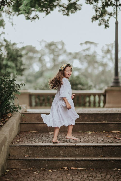 Portrait of girl walking up steps