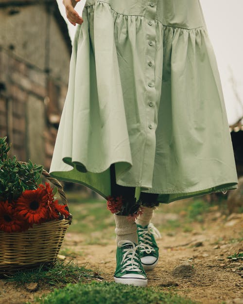 A Person Wearing Green Sneakers