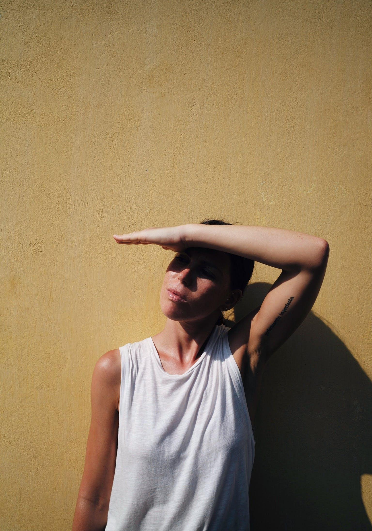 Woman in White Sleeveless Shirt