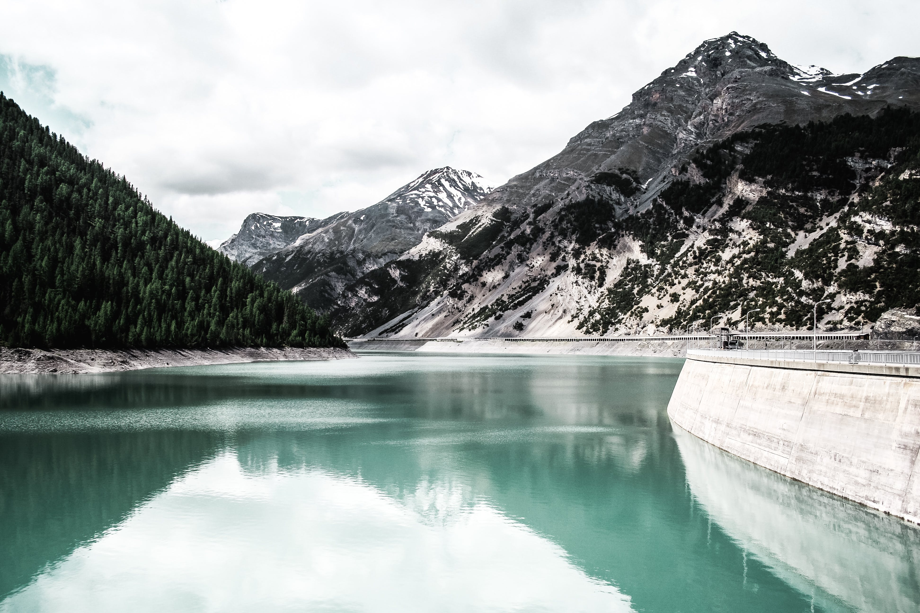 Landscape Photography of Body of Water Near Mountain