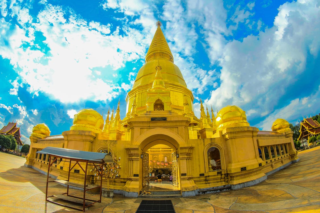 Gold Temple Under Cloudy Sky