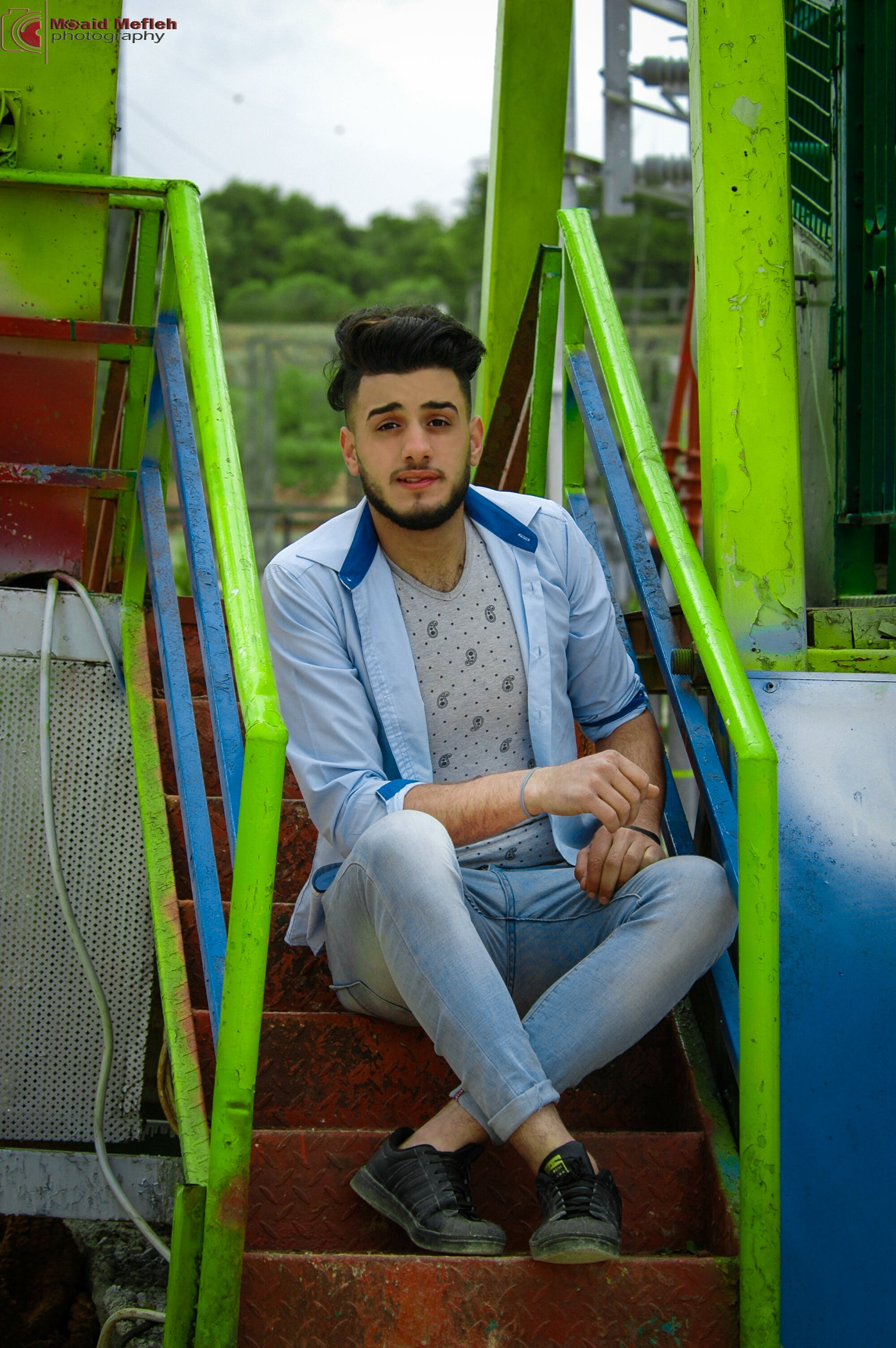 Man Wears Blue Dress Shirt Sitting on the Stair