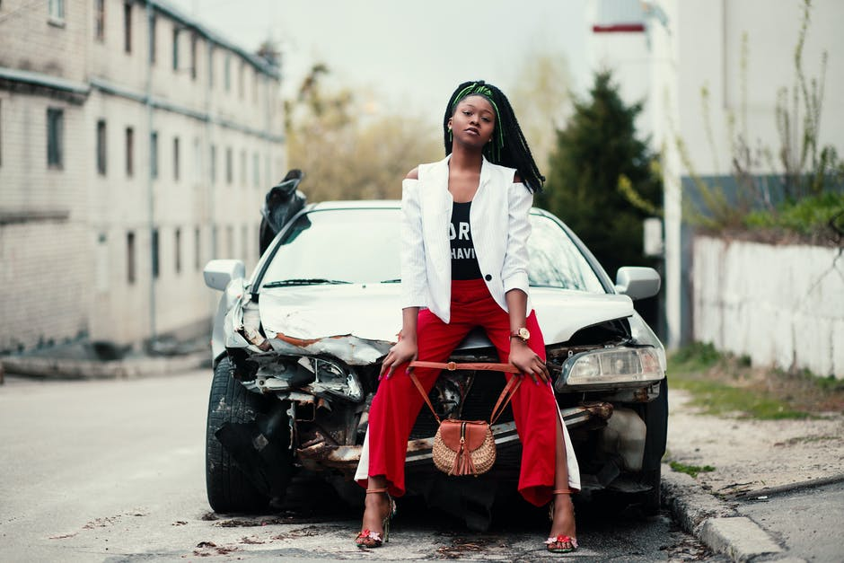 Woman Sitting in Front of the Car