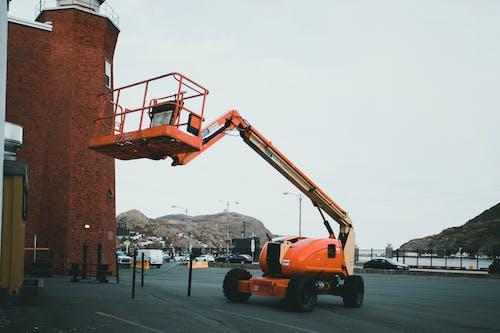 Orange and Black Heavy Equipment on Road
