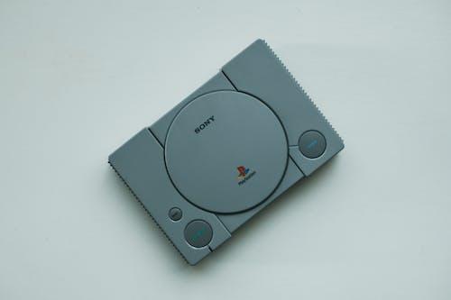 Gray Nintendo Game Controller on White Table