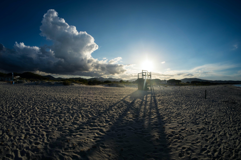 White Beach Sand Under Blue Sky during Daytime
