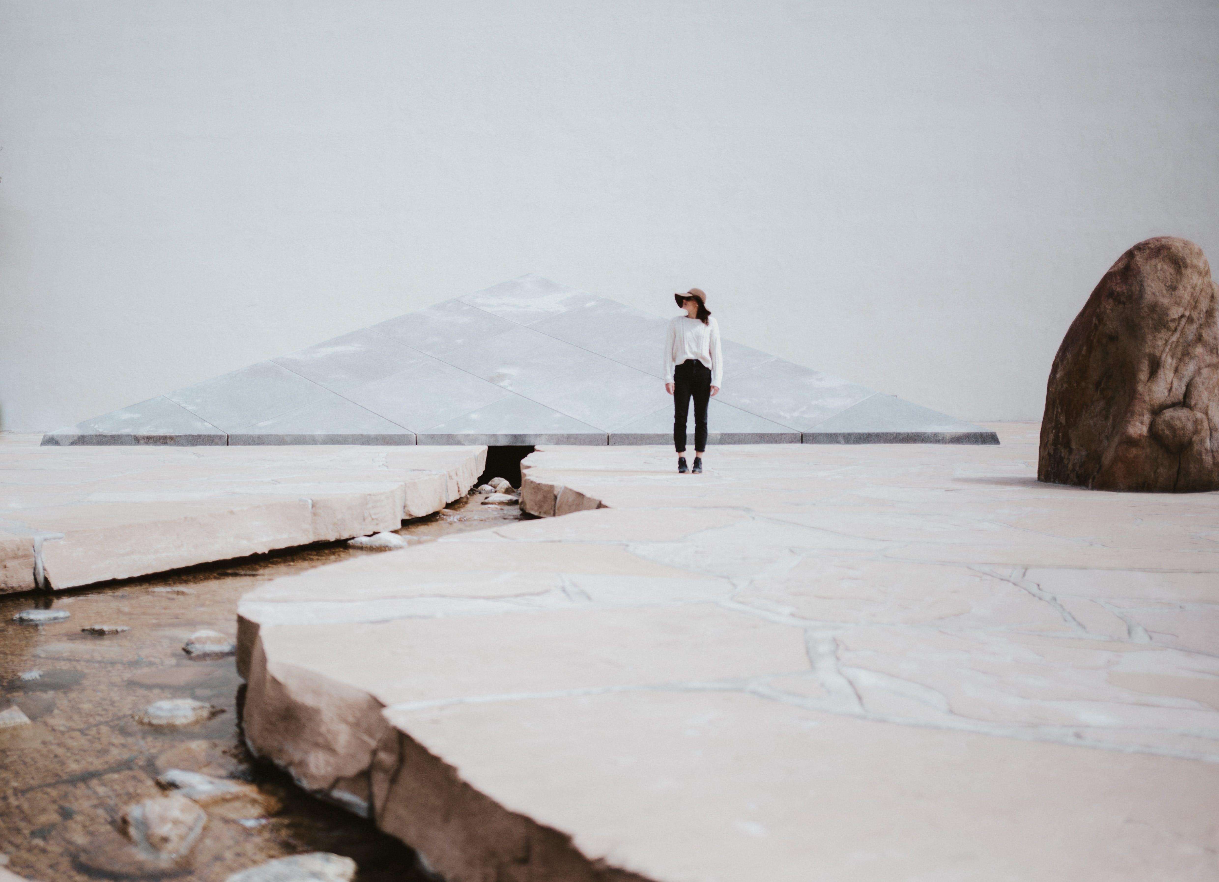 Woman Standing Near Big Rock