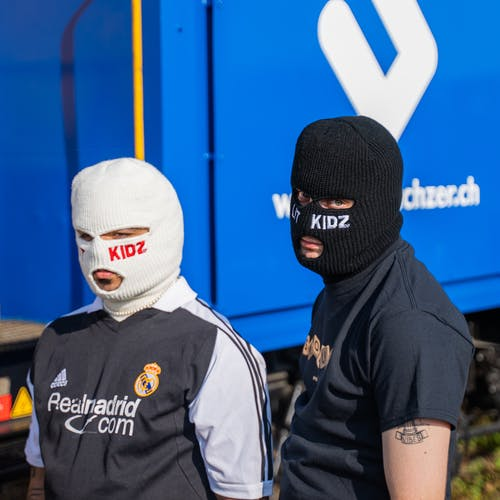 Man in Black and White Adidas Crew Neck T-shirt Wearing White Mask
