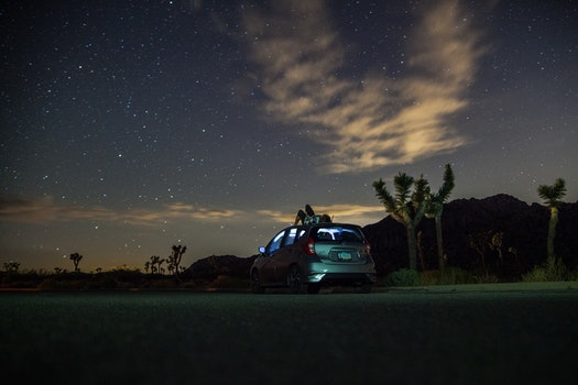 Gray Suv Under Blue Starry Sky during Nighttime