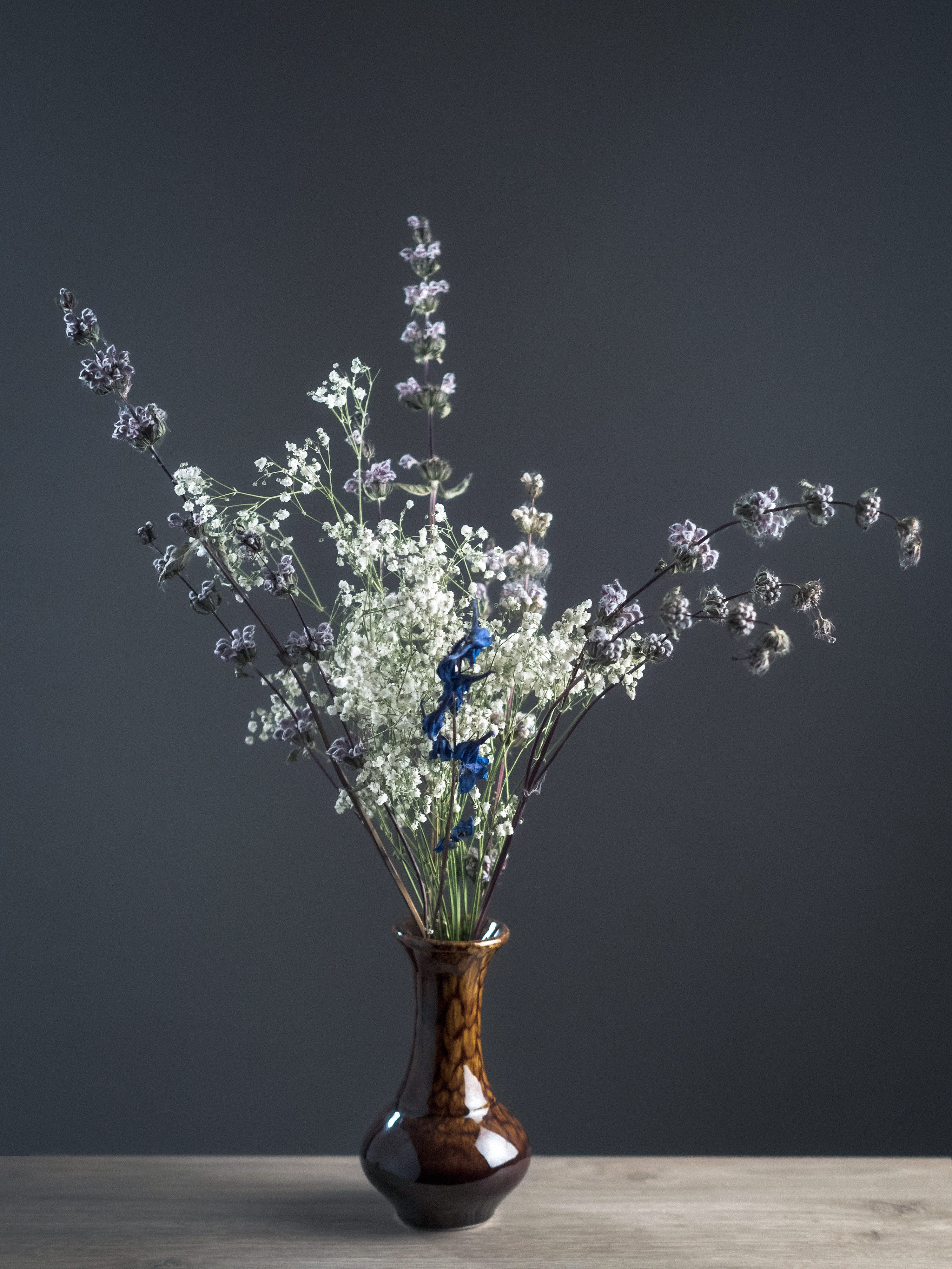 Shallow Focus Photography of White and Gray Flowers in Brown Ceramic Vase
