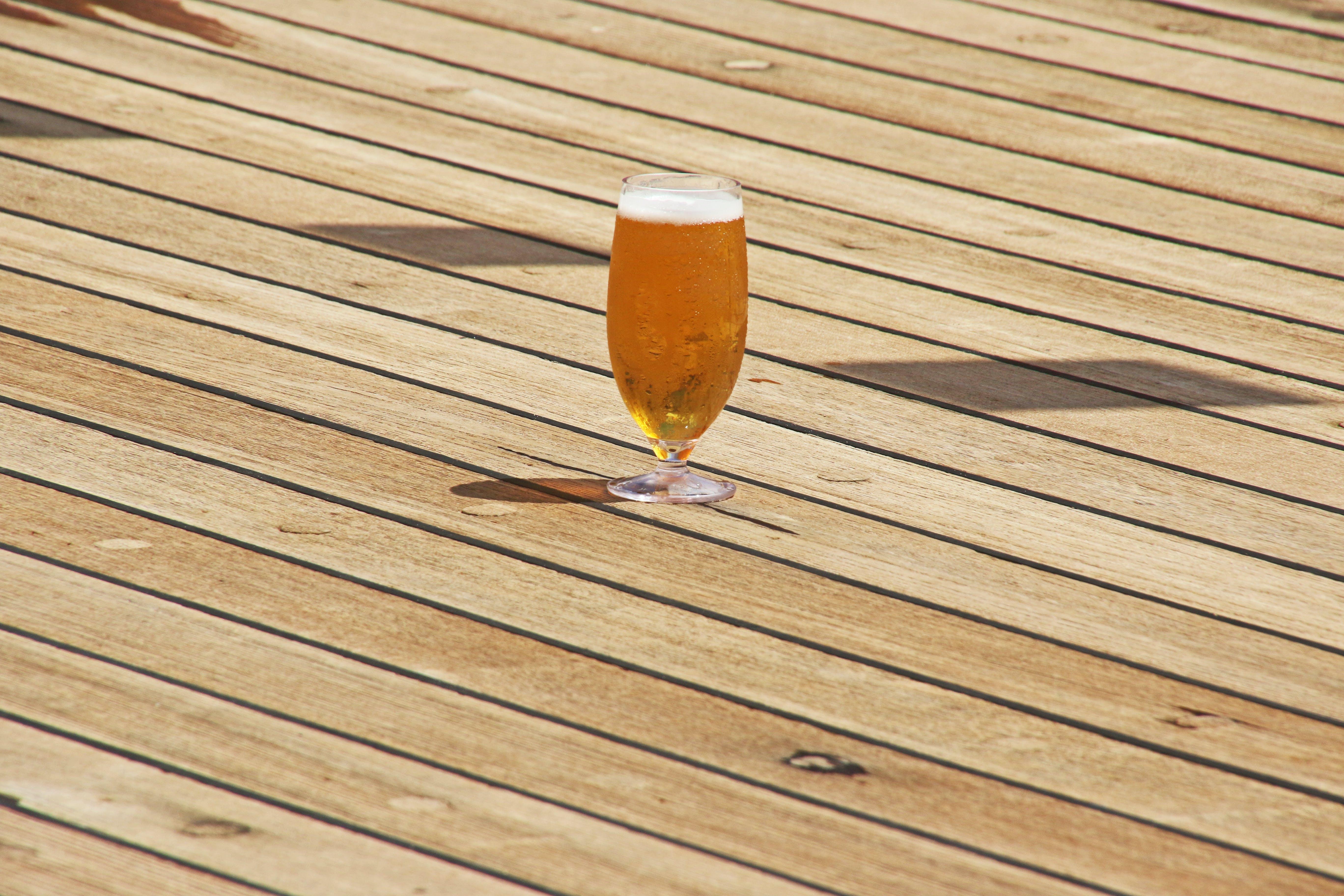 Clear Short-stem Wine Glass on Parquet Flooring