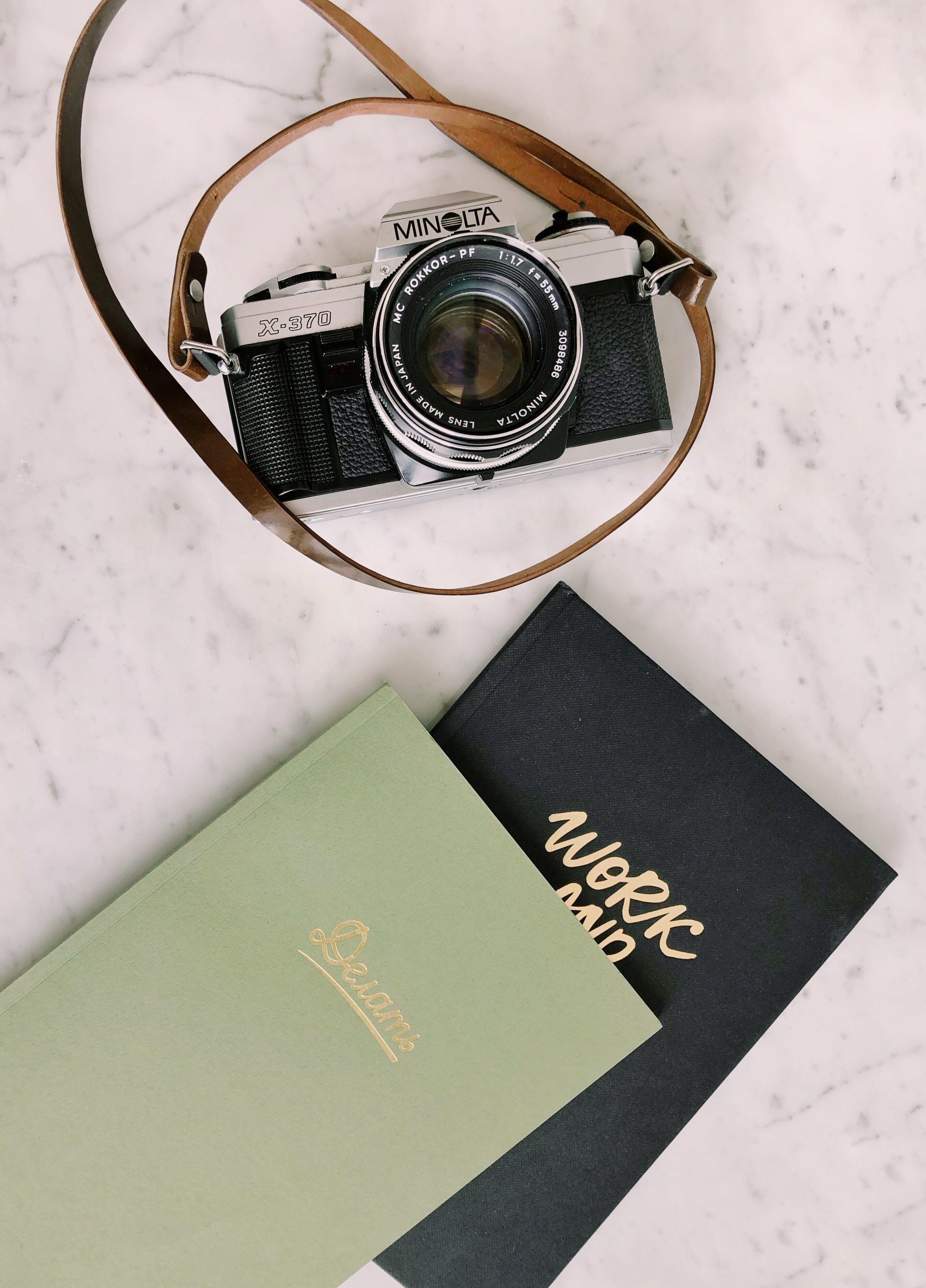 Black and Gray Minolta Milc Camera