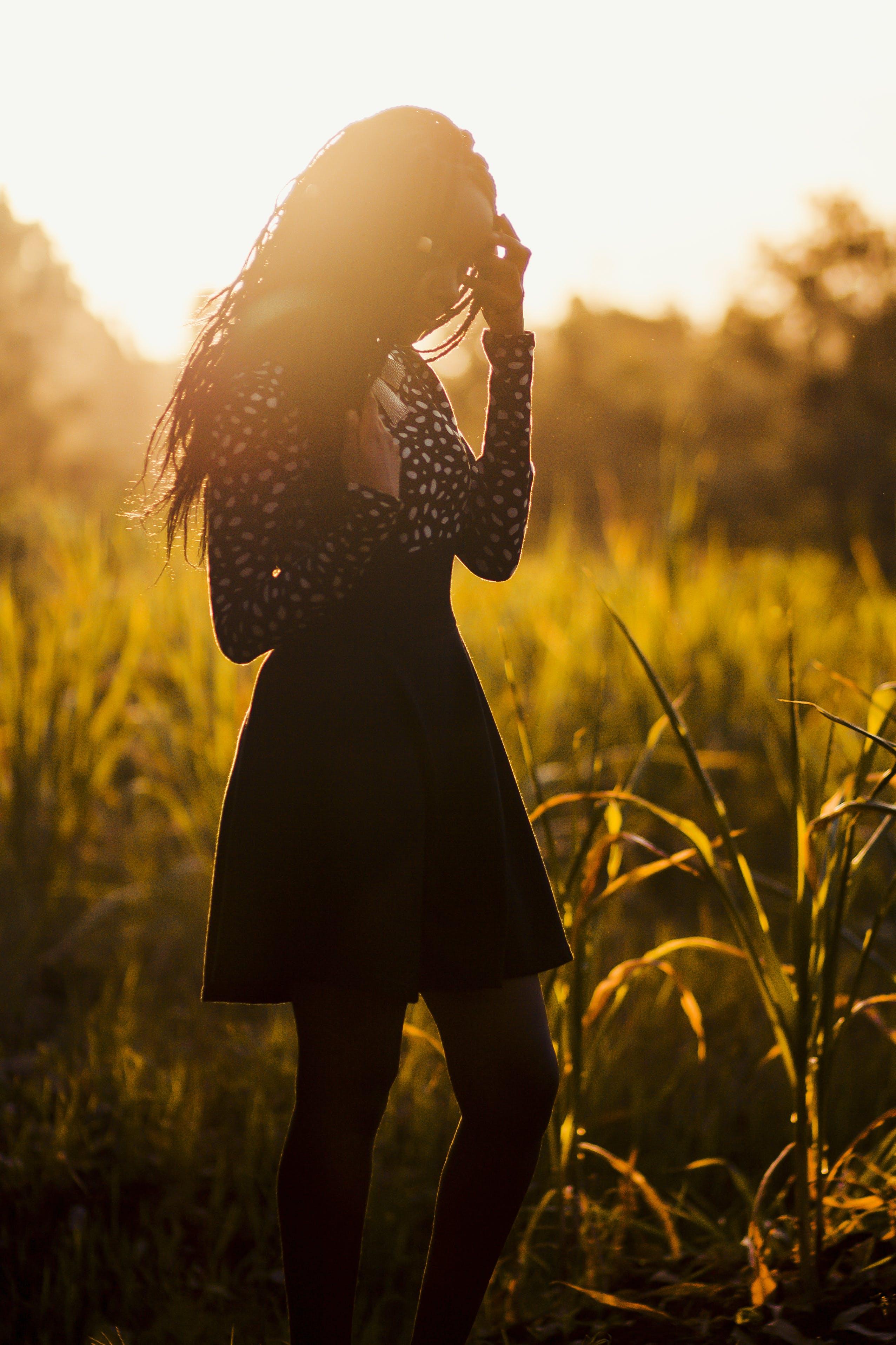 Woman Wearing Black Dress during Sunset