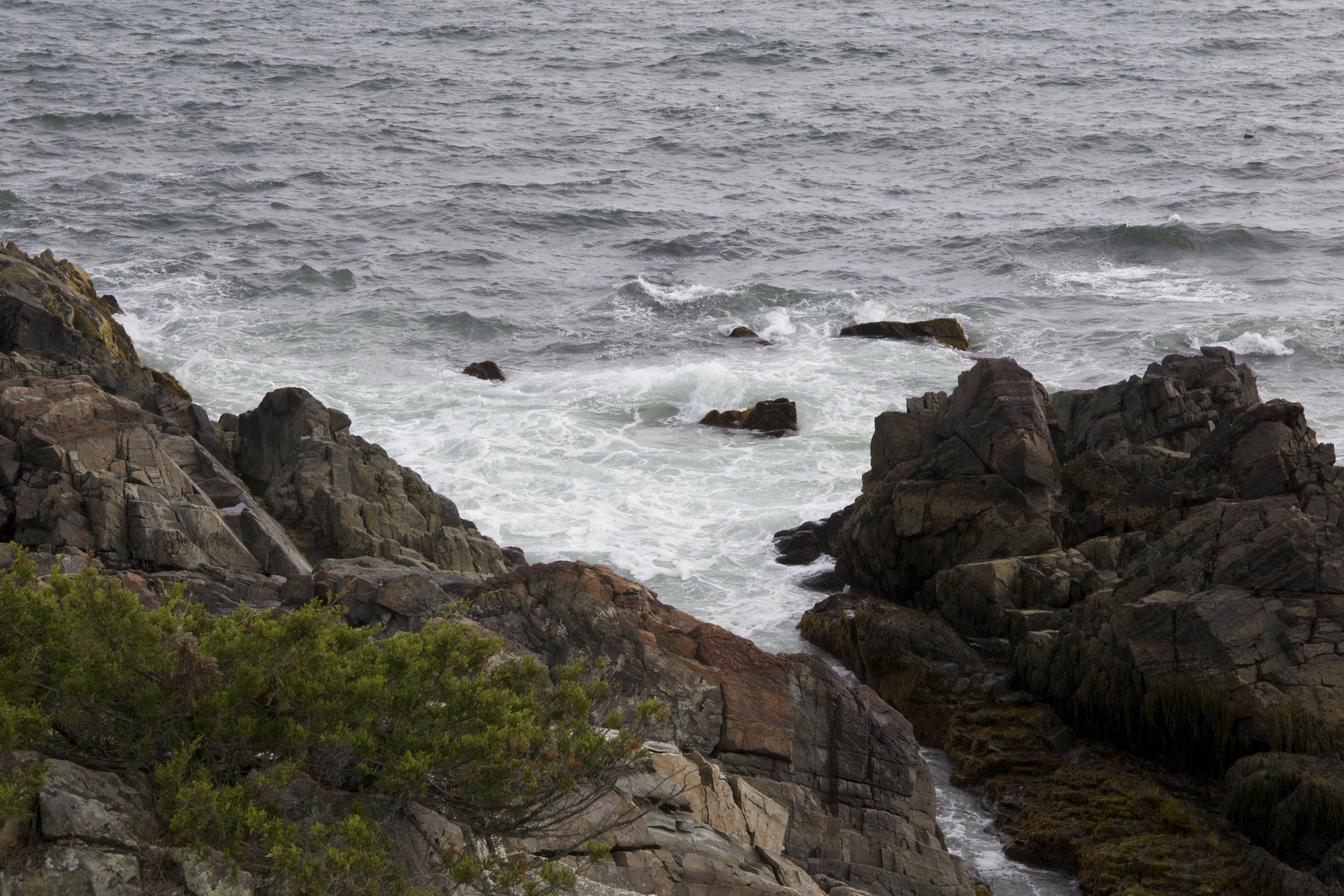 Mountain Rocks Near on Body of Water