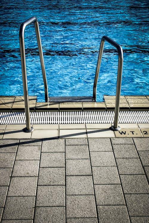 White Metal Railings Near Swimming Pool