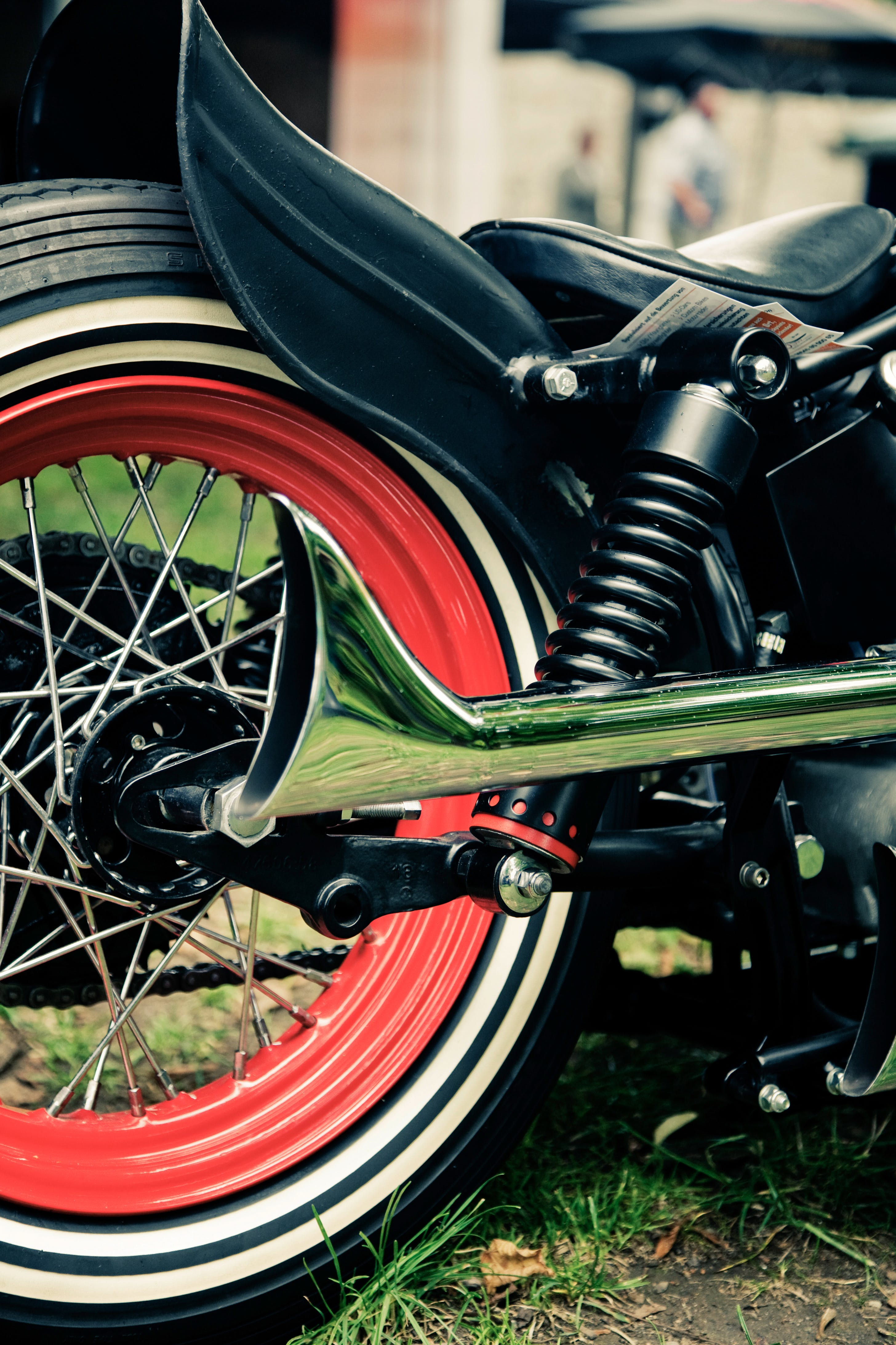 Silver Motorcycle Exhaust Pipe Near Black Fender during Daytime