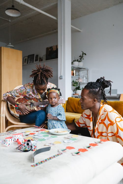 African American family spending time together playing music