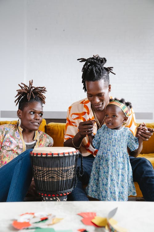 African family playing drum