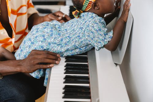 Child laying on portable piano