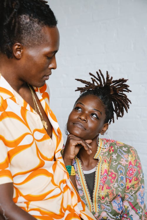 African man and woman looking at each other