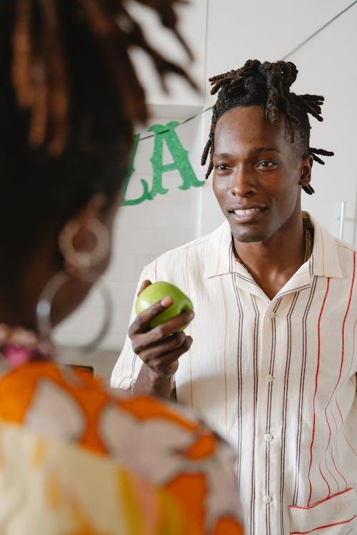 Man holding green apple