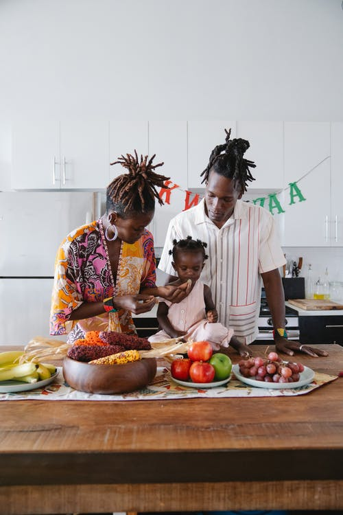 Mother, father and their daughter in the kitchen