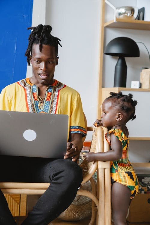Man using laptop with his daughter