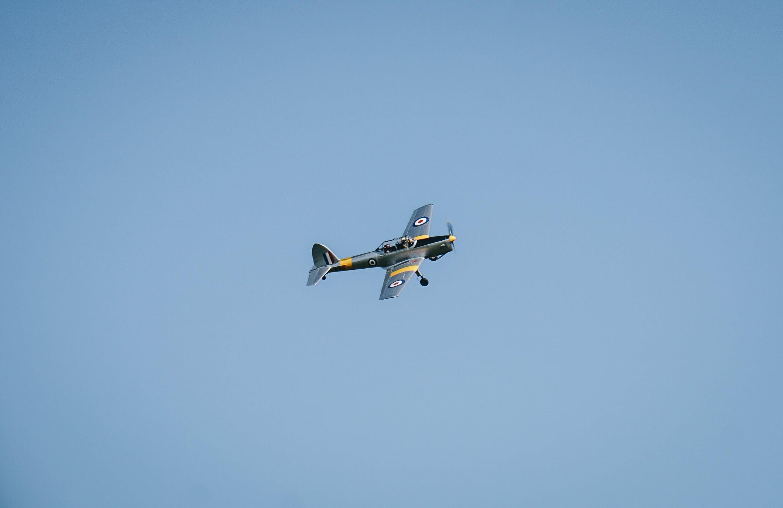 Gray Propeller Plane Under Blue Sky