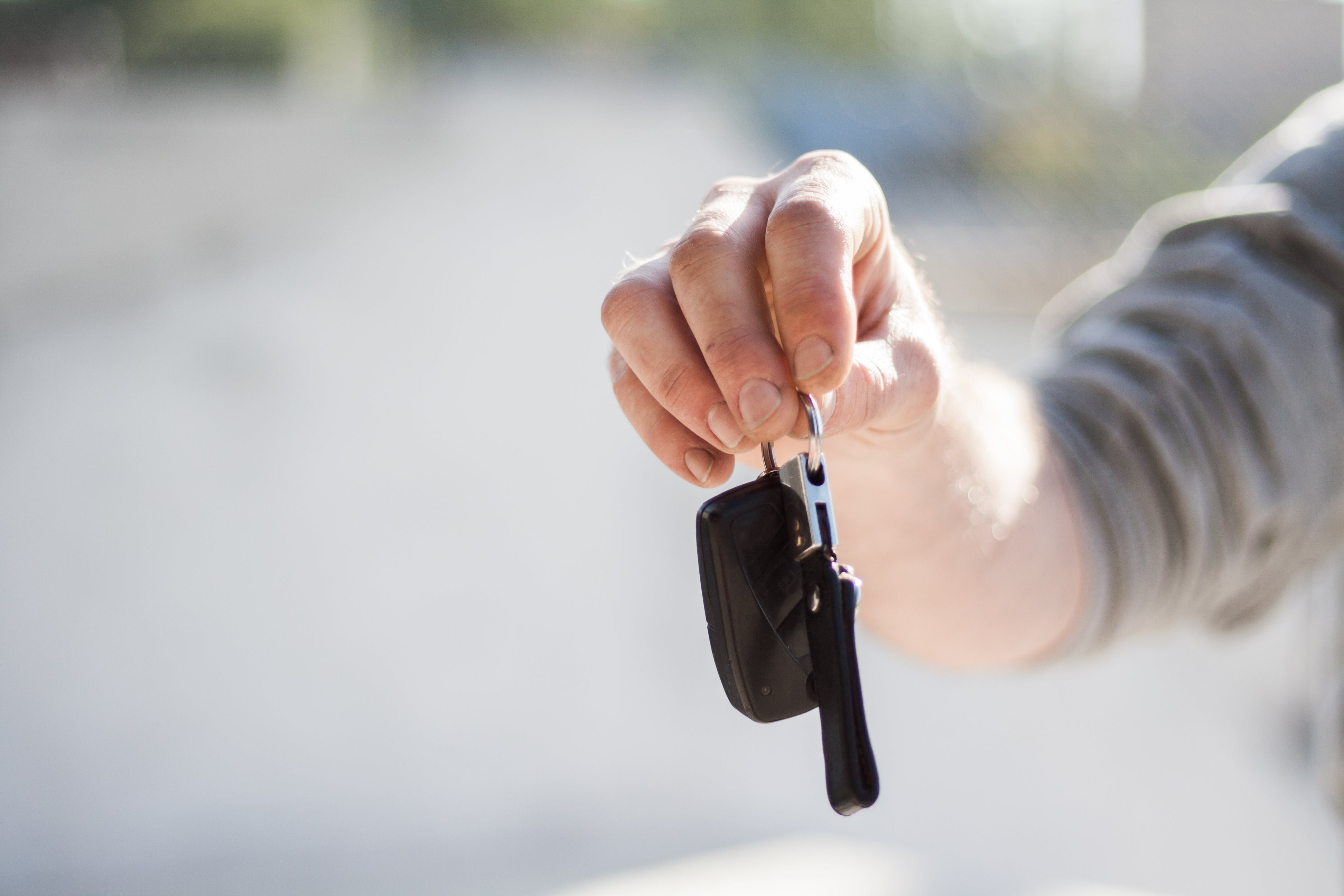 Person holding car keys to Insure a leased car in Western Massachusetts