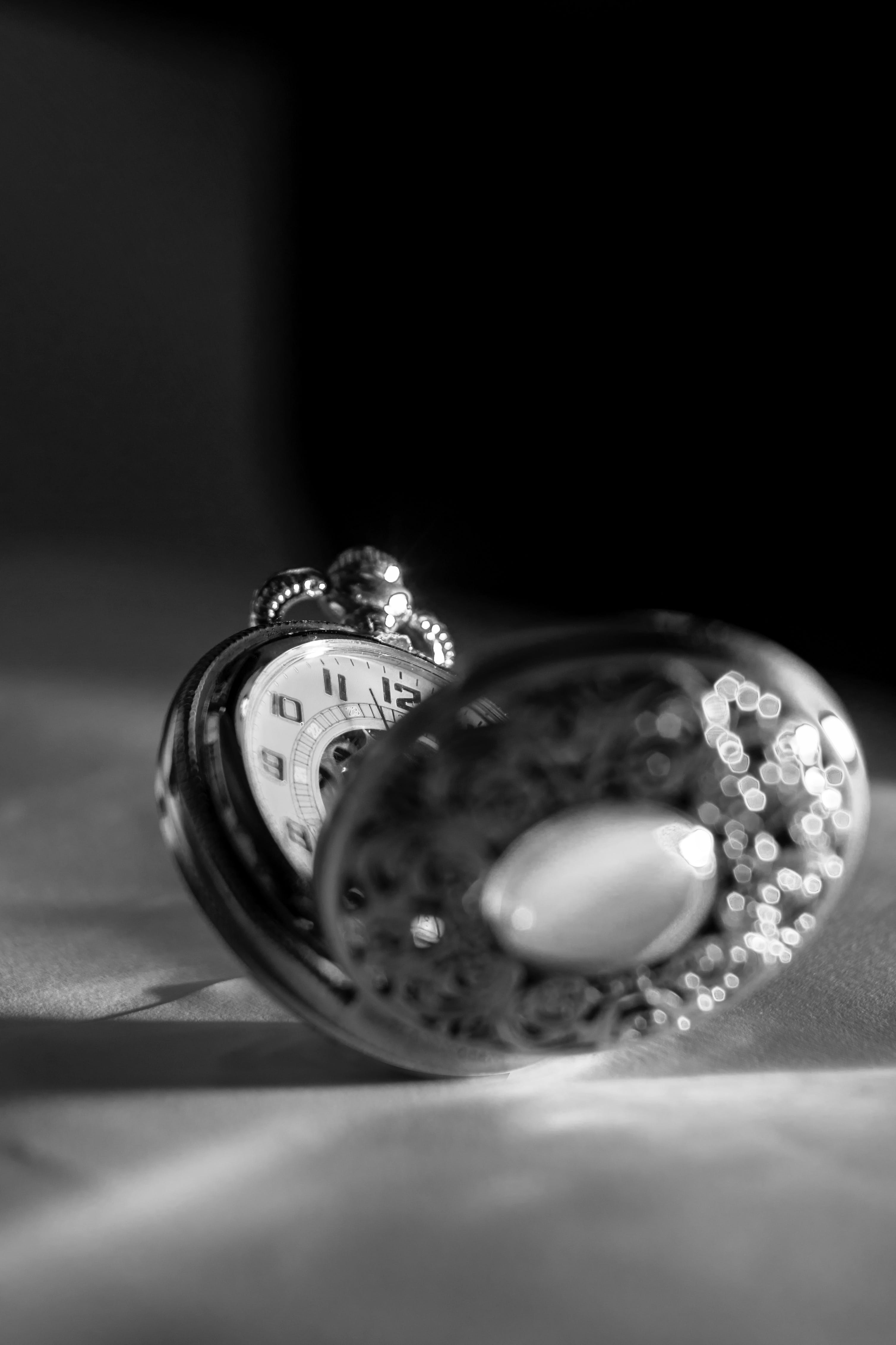 Grayscale Photo Of Pocket Watch