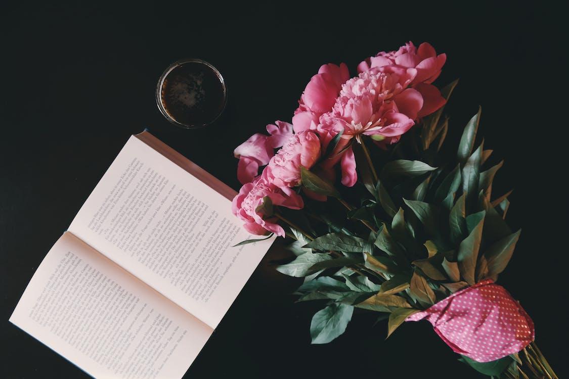 Pink Flower Bouquet Beside Opened Book