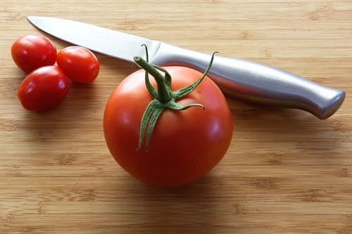 Tomatoes Near Knife