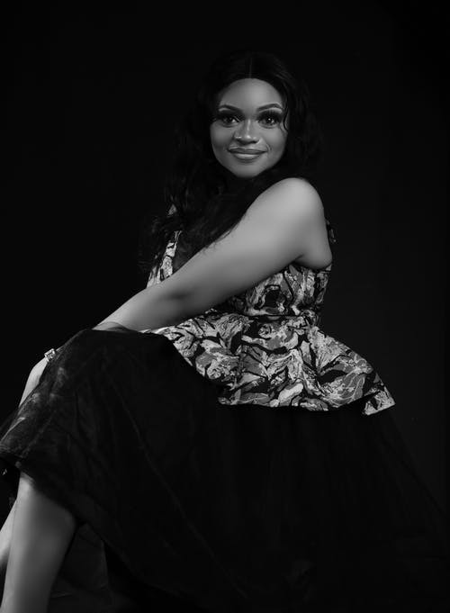 Grayscale Photo of Beautiful Woman in a Floral Dress Looking at the Camera