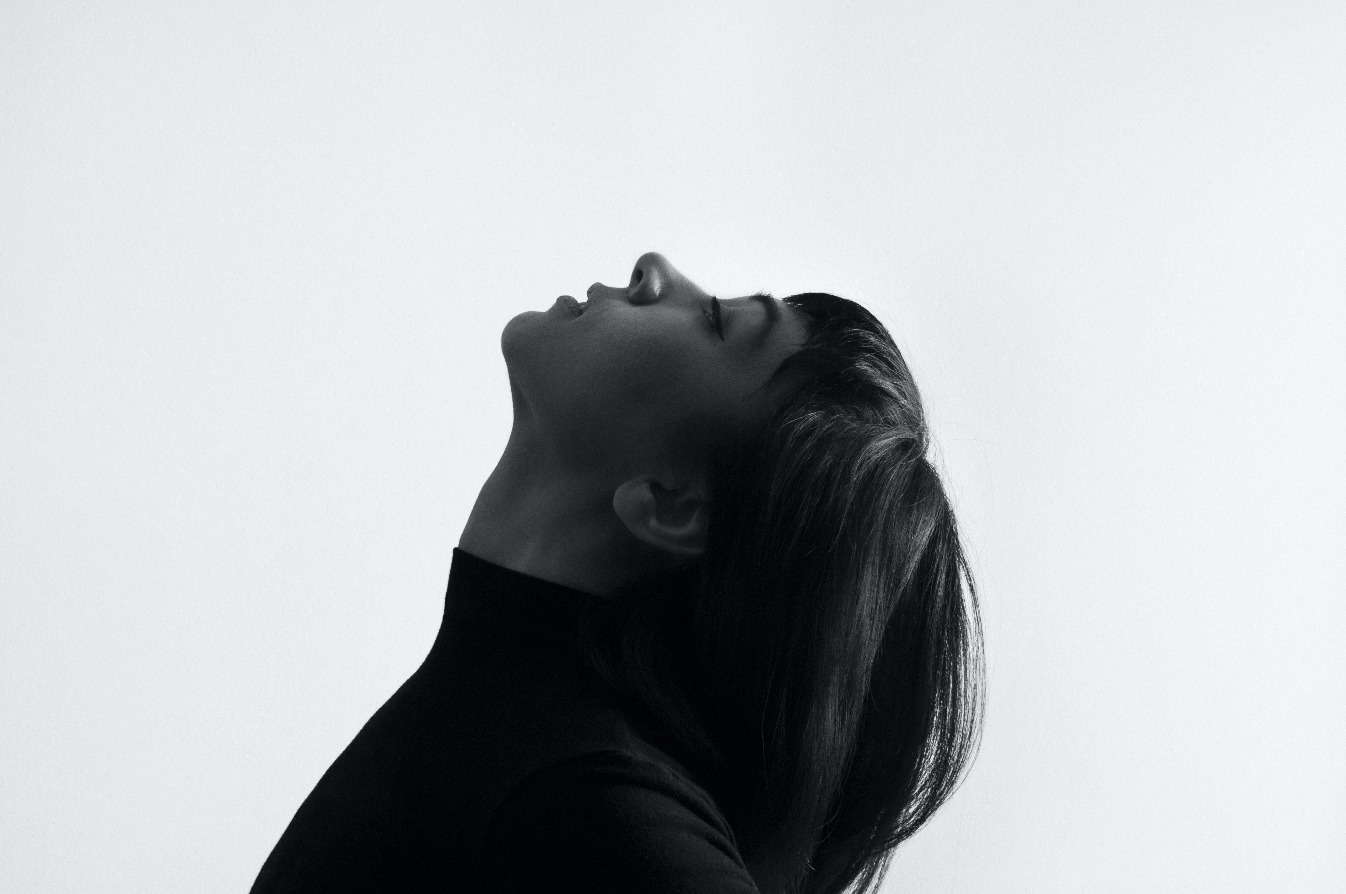 Female Grayscale Photo Facing Upward