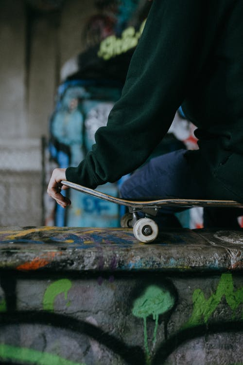 Close up on mans hand on skateboard