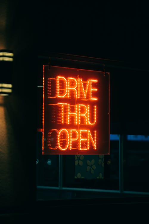 Close up view of neon drivethru sign