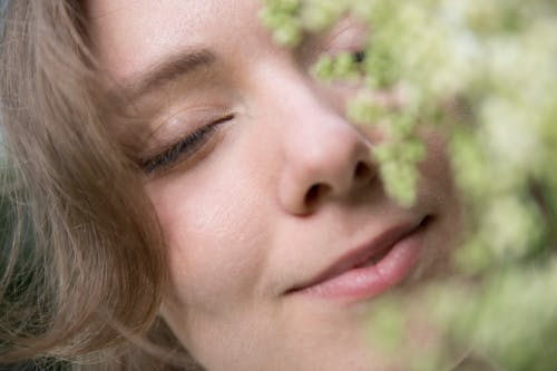 Womans Face in Close Up Photography