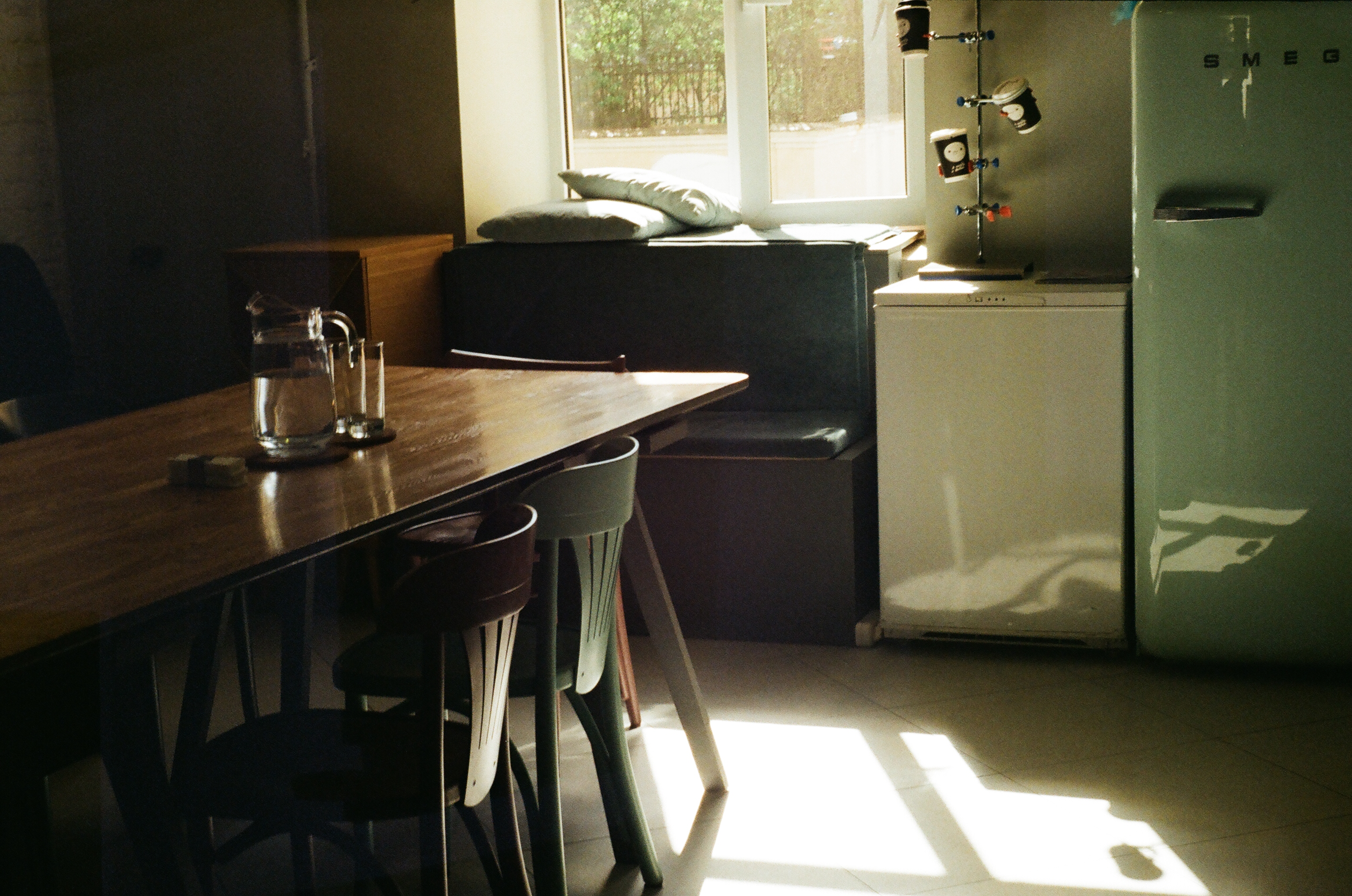Rectangular Brown Wooden Table and Two Chairs