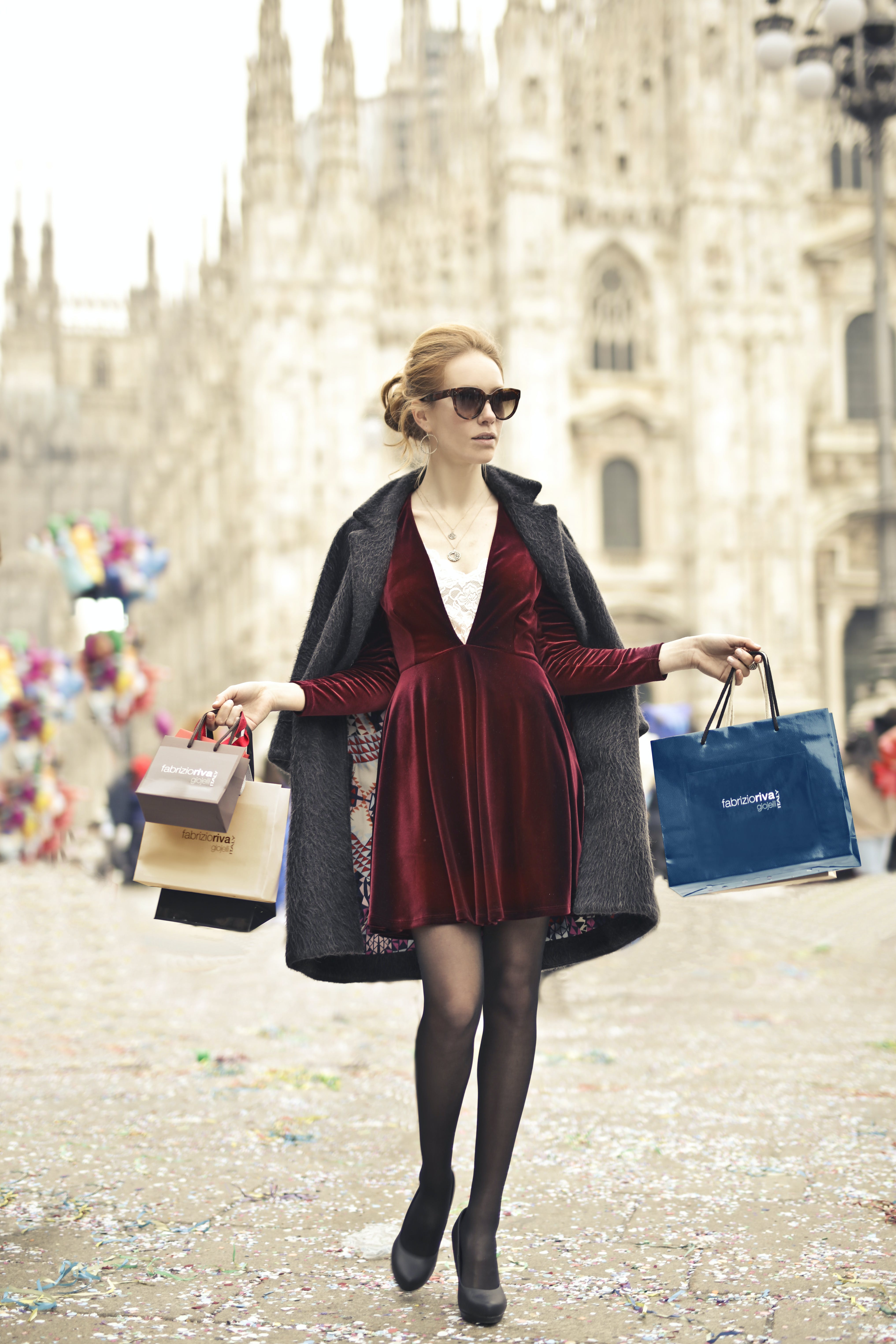 Photo of a Woman Holding Shopping Bags
