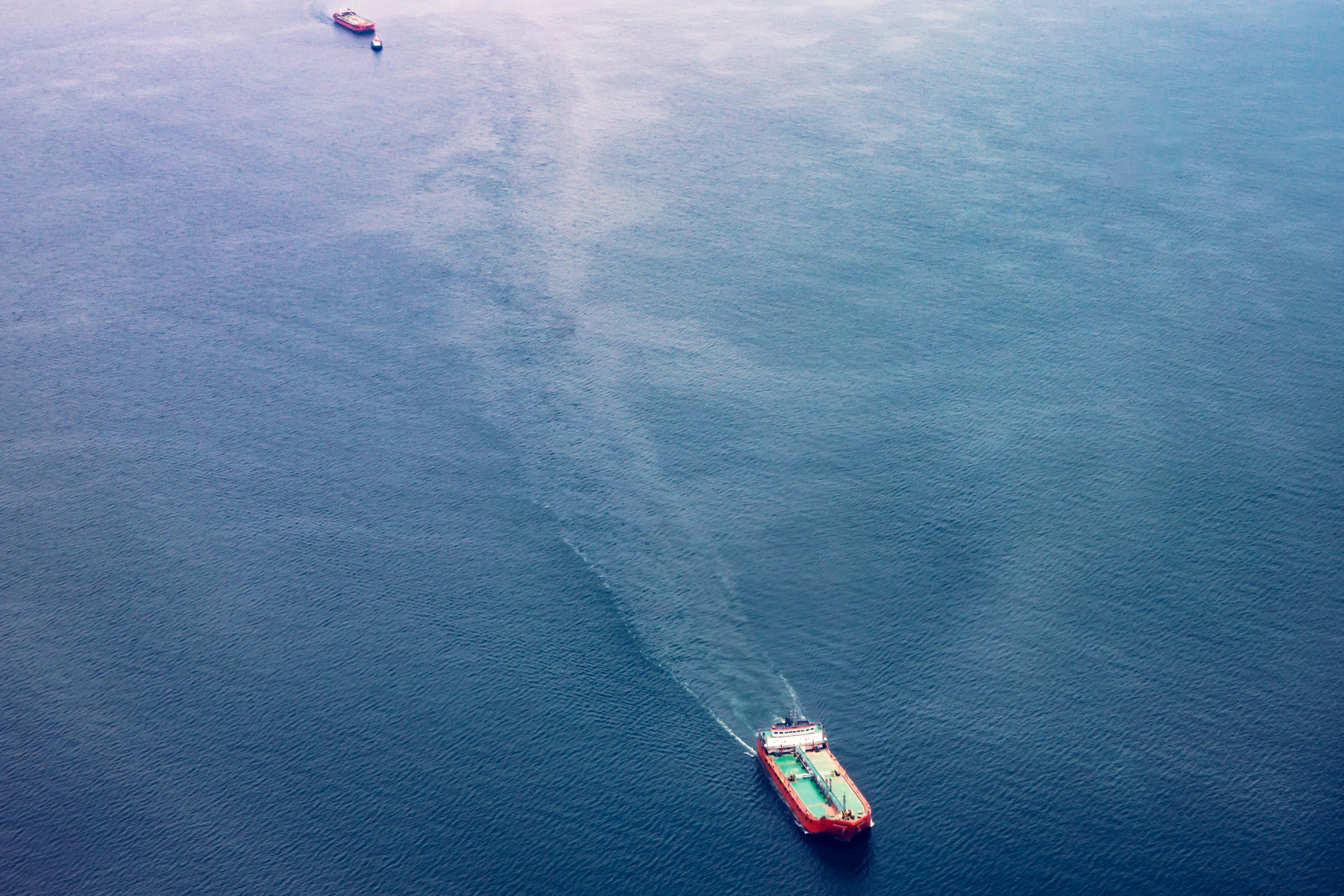 Red, White, and Teal Cargo Ship on Water