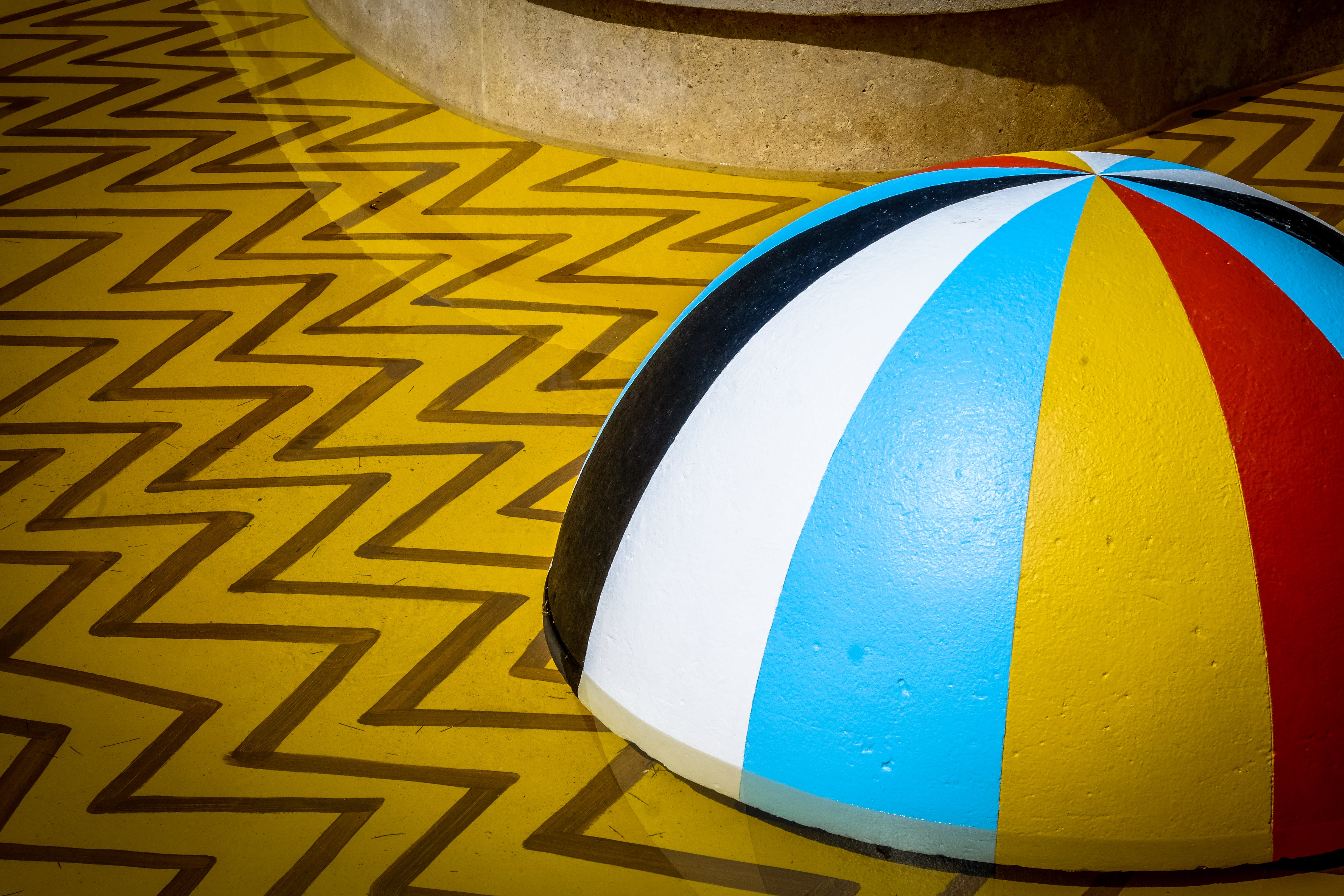 Multicolored Lid on Chevron Flooring