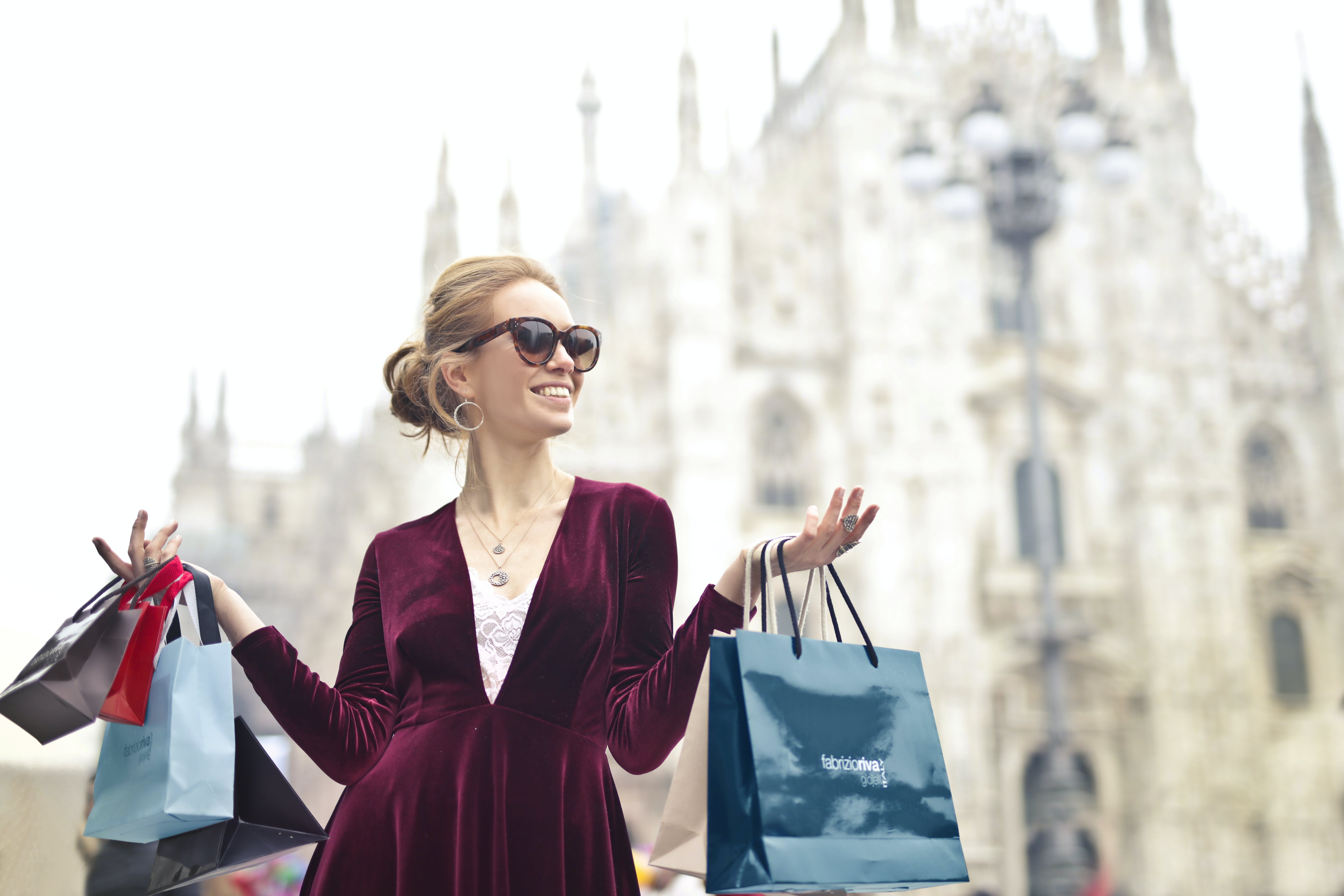 Woman Wearing Maroon Velvet Plunge-neck Long-sleeved Dress While Carrying Several Paper Bags Photography