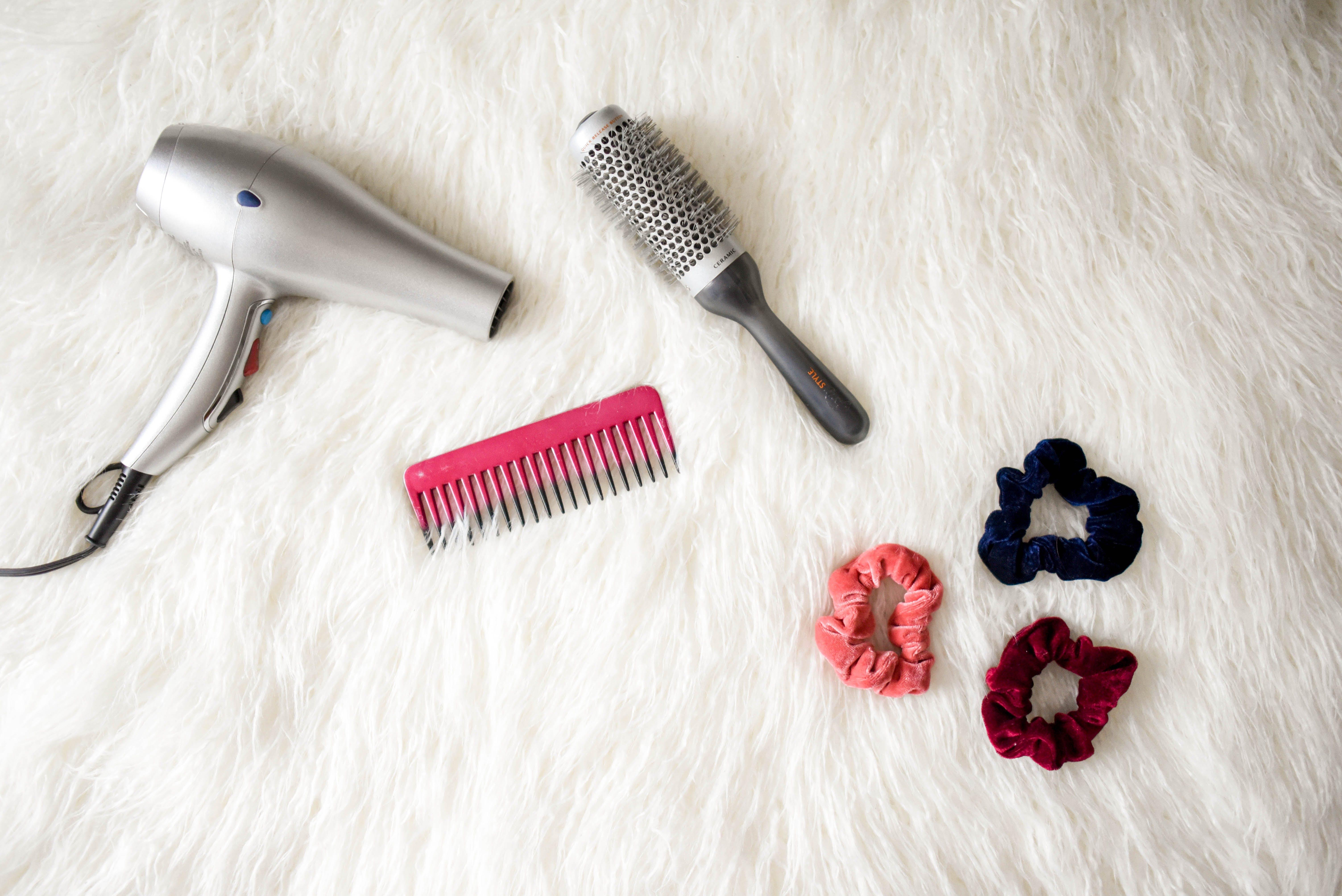 Grey Hair Blower Near Pink Hair Combs and Scrunchies