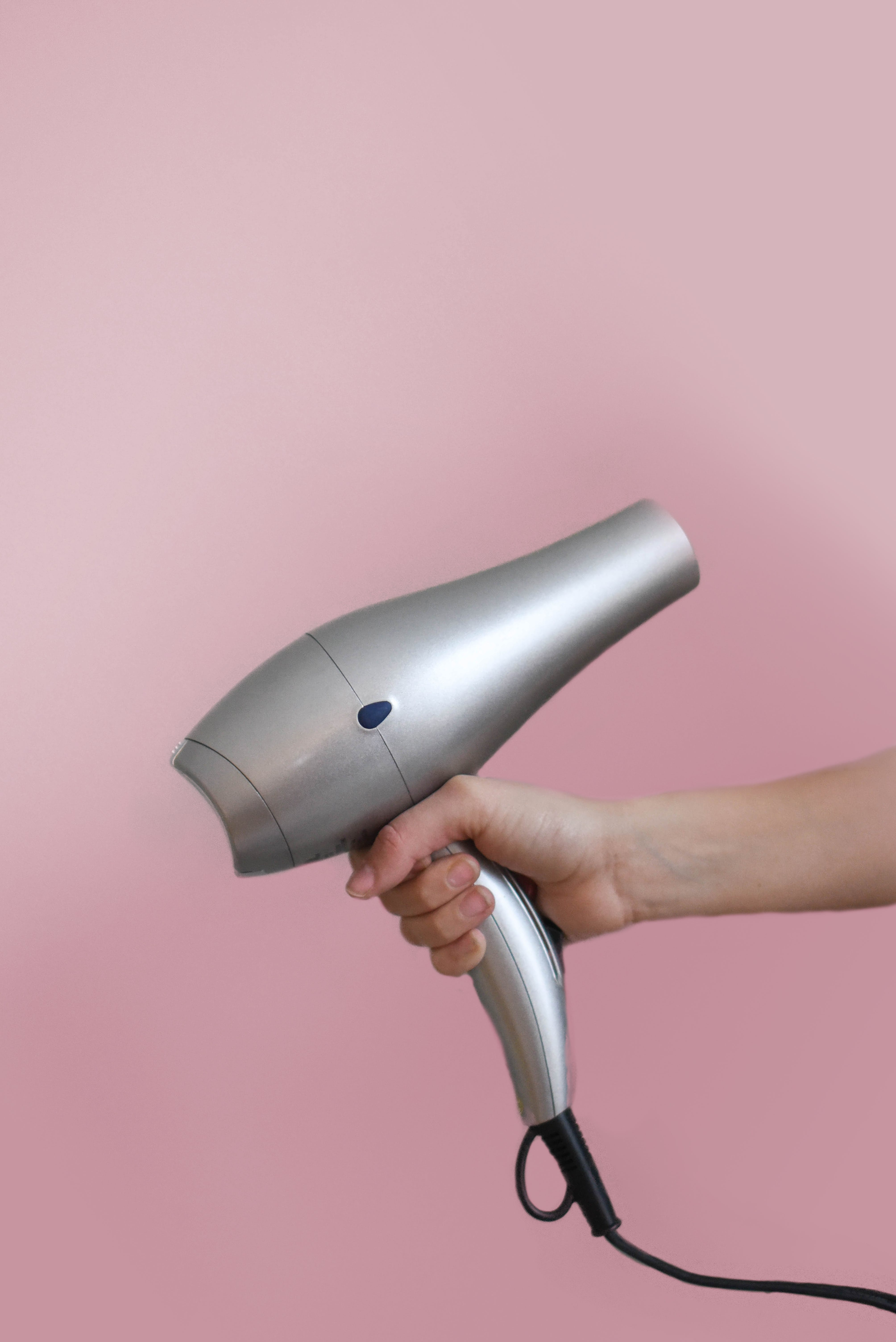 Person Holding Grey Hair Dryer