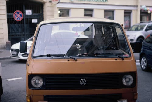A Brown Van Parked on the Road
