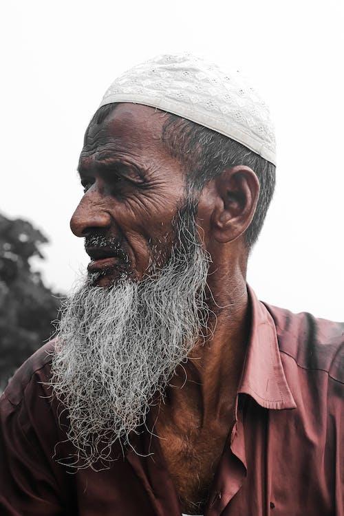 Close-Up Shot of an Elderly Bearded Man
