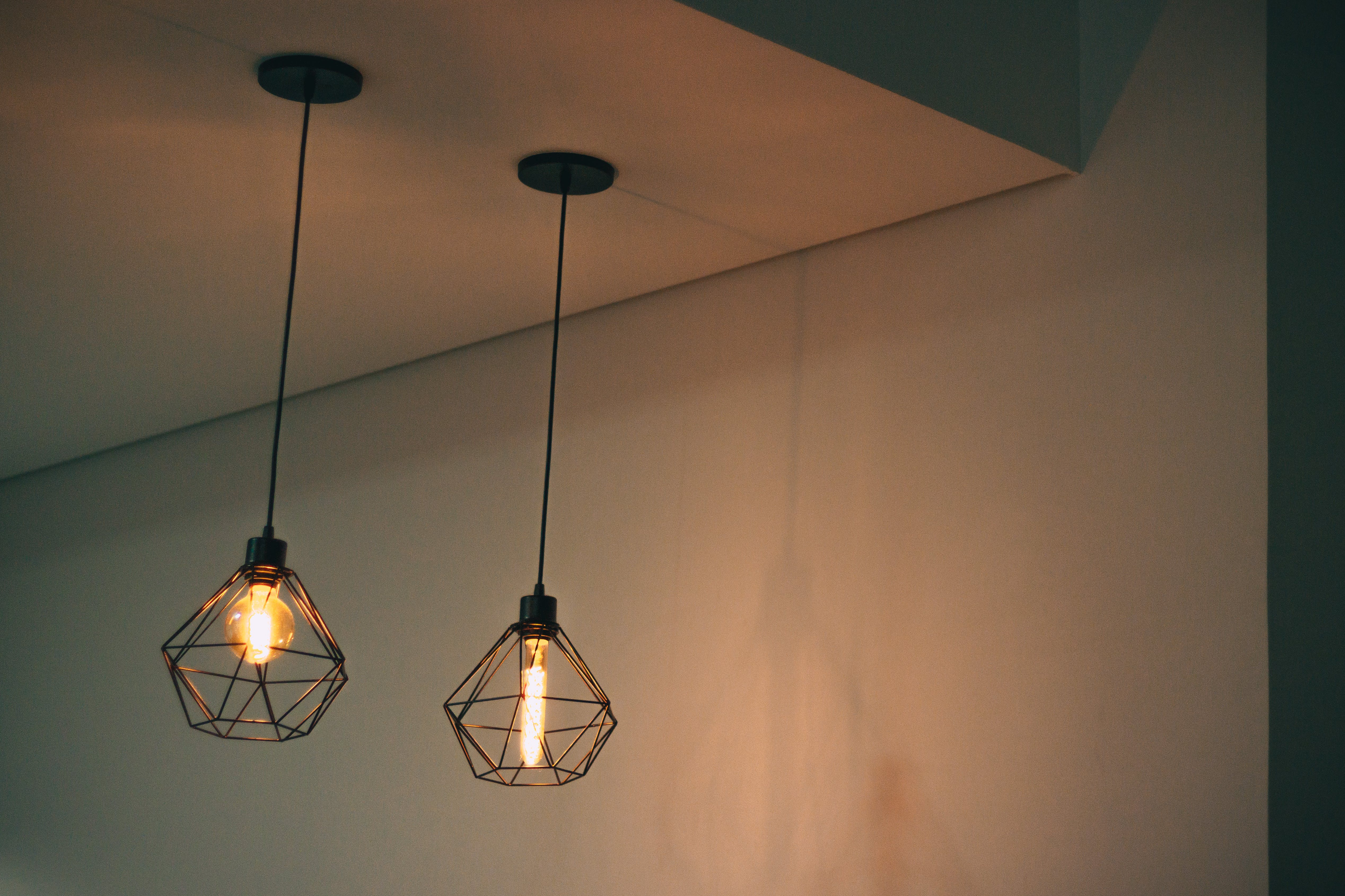 Two Black Pendant Lamp on White Concrete Ceiling